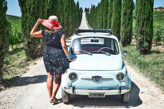 Photo of Ilaria Vangi in tourist on Fiat 500 and Tuscan countryside background